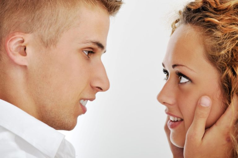 Image of a beatiful young couple looking at each other and smiling